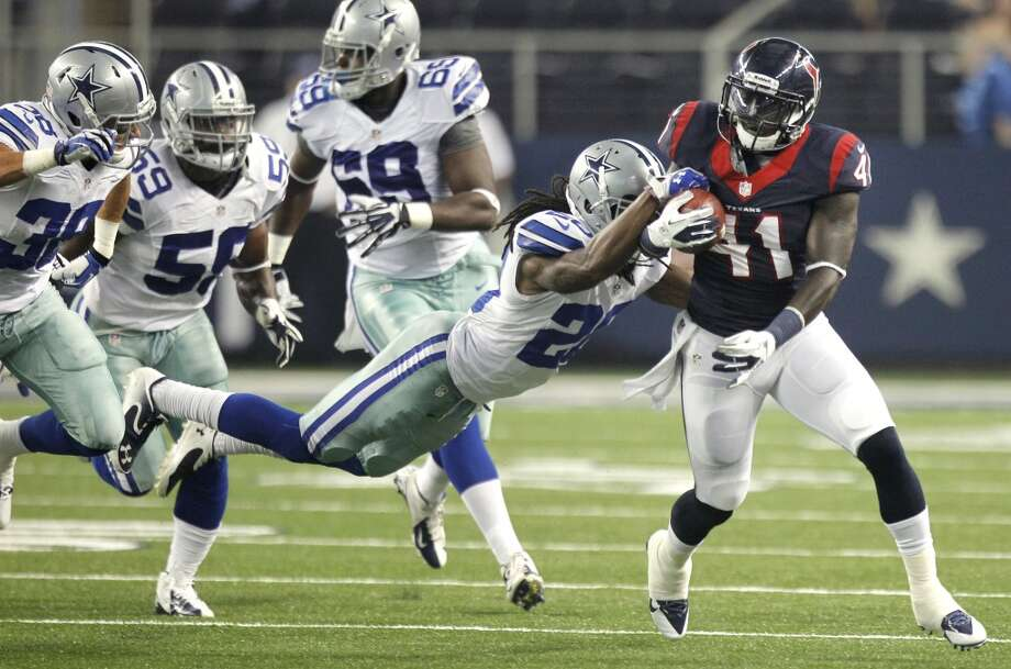 Texans running back Cierre Wood pulls away from Cowboys cornerback B.W. Webb. Photo: Brett Coomer, Houston Chronicle