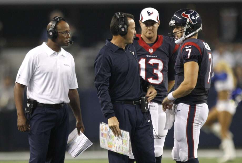Texans quarterback sCase Keenum and T.J. Yates talk to Texans head coach Gary Kubiak and quarterbacks coach Karl Dorrell, far left, during a time out. Photo: Brett Coomer, Houston Chronicle