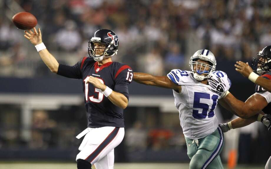 Texans quarterback T.J. Yates is pressured by Cowboys defensive end Kyle Wilber as he throws a 21-yard touchdown pass to receiver Andy Cruse. Photo: Brett Coomer, Houston Chronicle