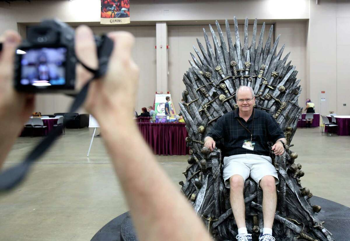 Bob Morse has his photo taken in the Game of Thrones chair by his brother-in-law Jim Bowling at the 71st World Science Fiction Convention Thursday, Aug. 29, at the Convention Center. The 5-day event celebrates sci-fi and fantasy across various mediums with all sorts of writers, artists and fans in attendance.