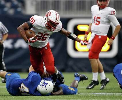 Katy's Rodney Anderson (26) is tackled by Klein's Ethan Johnson during the first half of a high school football game, Thursday, August 29, 2013 at Reliant Stadium in Houston, TX. Photo: Eric Christian Smith, For The Chronicle