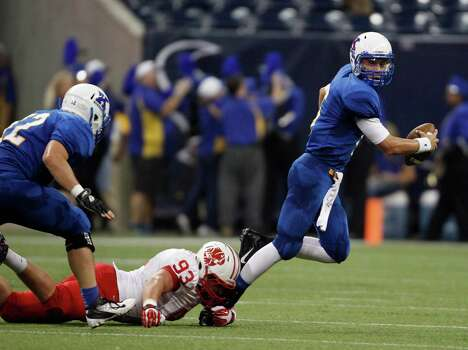 Klein quarterback Rainer Ausmus is sacked by Katy's Cody Gessier during the first half of a high school football game, Thursday, August 29, 2013 at Reliant Stadium in Houston, TX. Photo: Eric Christian Smith, For The Chronicle