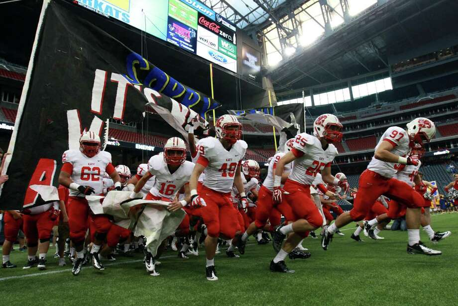 The Katy Tigers take the field to face the Klein Bearkats for their season-opening game, Thursday, August 29, 2013 at Reliant Stadium in Houston, TX. Photo: Eric Christian Smith, For The Chronicle