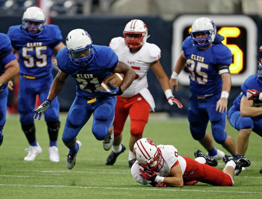 Klein's David Hamm escapes the tackle of Katy's Travis Whillock during the first half of a high school football game, Thursday, August 29, 2013 at Reliant Stadium in Houston, TX. Photo: Eric Christian Smith, For The Chronicle