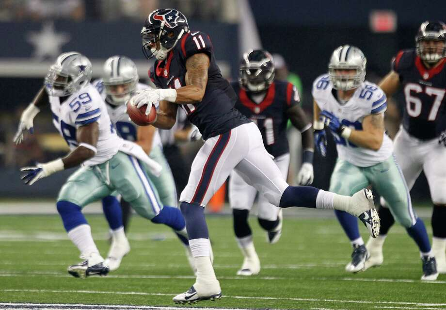 Less than eight months after he tore his Achilles tendon, DeVier Posey (11) was back on the field for the Texans, totaling two catches for 18 yards Thursday. Photo: Brett Coomer, Staff / © 2013  Houston Chronicle
