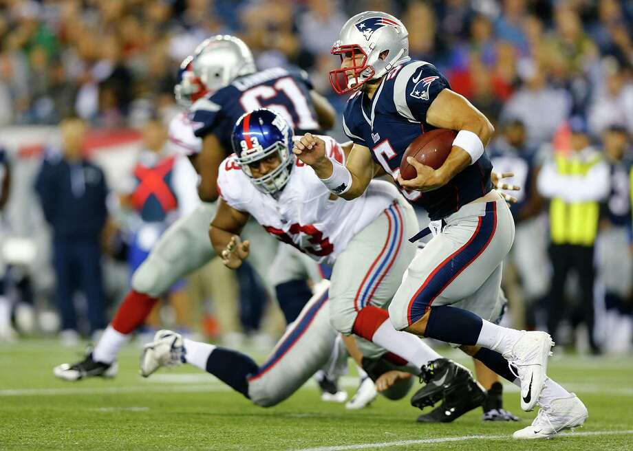 Tim Tebow did nothing Thursday night to convince the Patriots he should remain a backup quarterback. Photo: Jared Wickerham, Staff / 2013 Getty Images