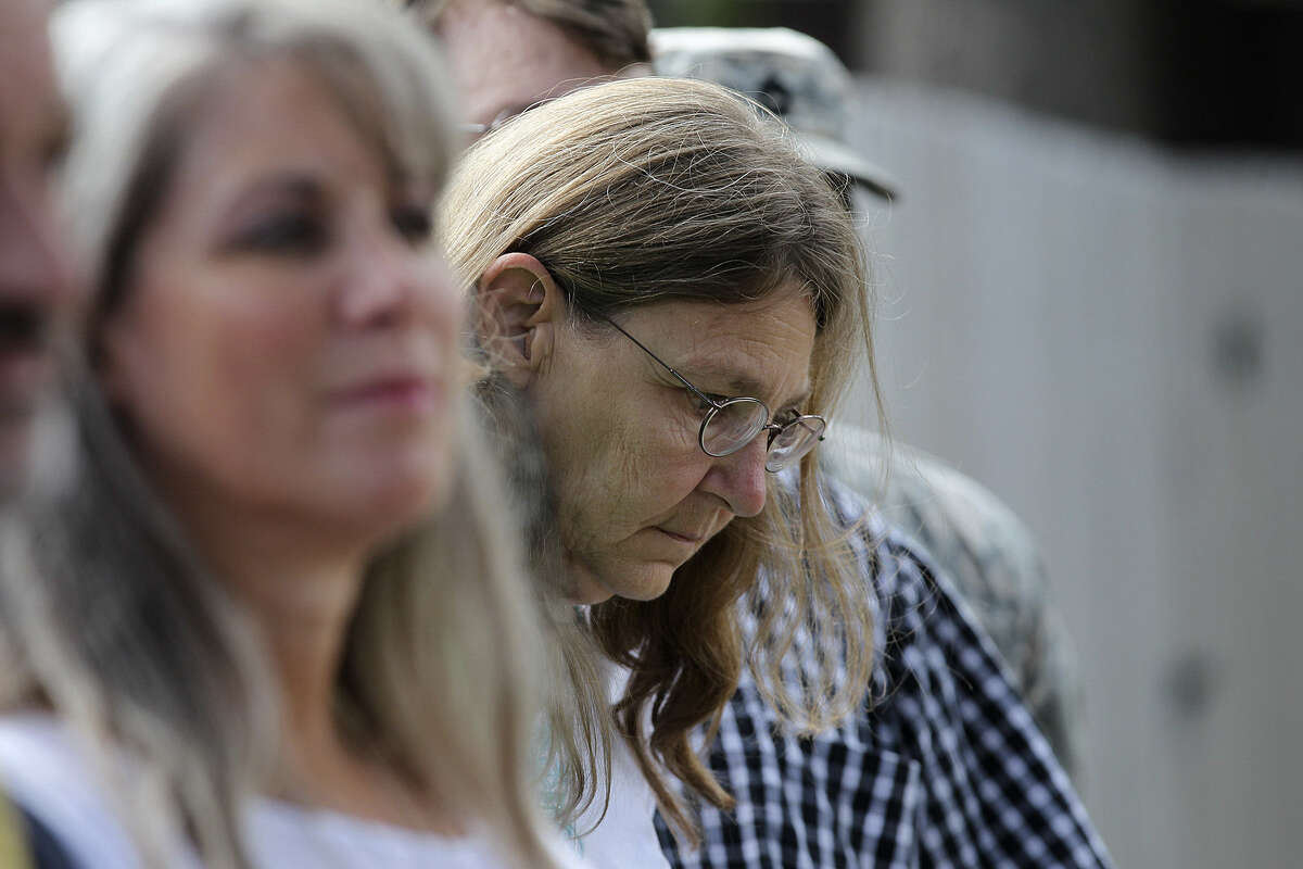 Joleen Cahill lowers her head during a news conference after Nidal Hasan was sentenced to death for his bloody shooting rampage in 2009 at Fort Hood.