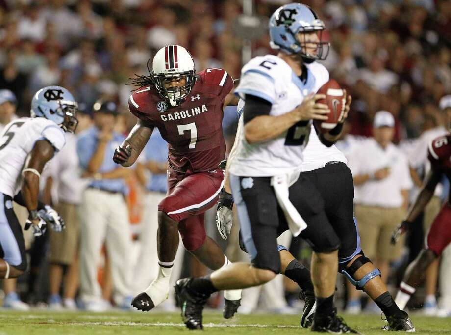 South Carolina defensive end Jadeveon Clowney (7) sets his sights on North Carolina QB Bryn Renner during the No. 6 Gamecocks' rain-delayed 27-10 victory. Photo: Gerry Melendez / McClatchy-Tribune News Service