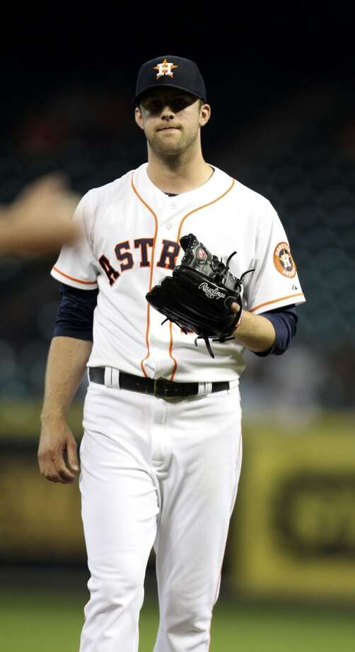 Astros starting pitcher Jordan Lyles reacts after giving up a home run to Nick Franklin. Photo: Karen Warren, Houston Chronicle