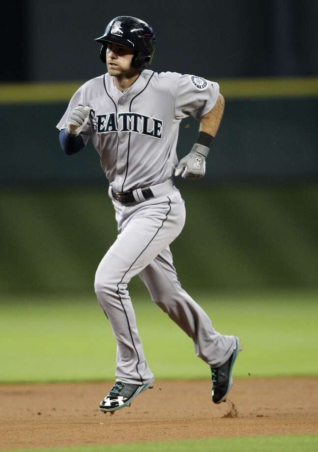 Mariners second baseman Nick Franklin runs the bases after his home run. Photo: Karen Warren, Houston Chronicle