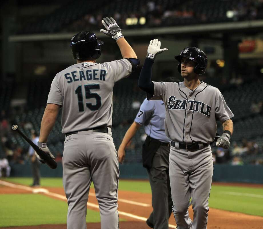 Mariners second baseman Nick Franklin celebrates his solo home run with teammate Kyle Seager. Photo: Karen Warren, Houston Chronicle