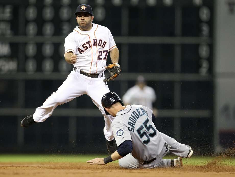 Astros second baseman Jose Altuve tags Mariners center fielder Michael Saunders out at second during a double play. Photo: Karen Warren, Houston Chronicle