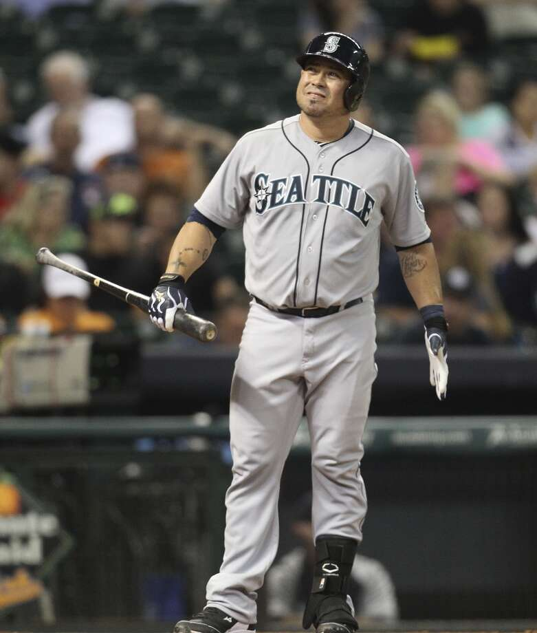 Mariners catcher Humberto Quintero reacts to a strike. Photo: Karen Warren, Houston Chronicle