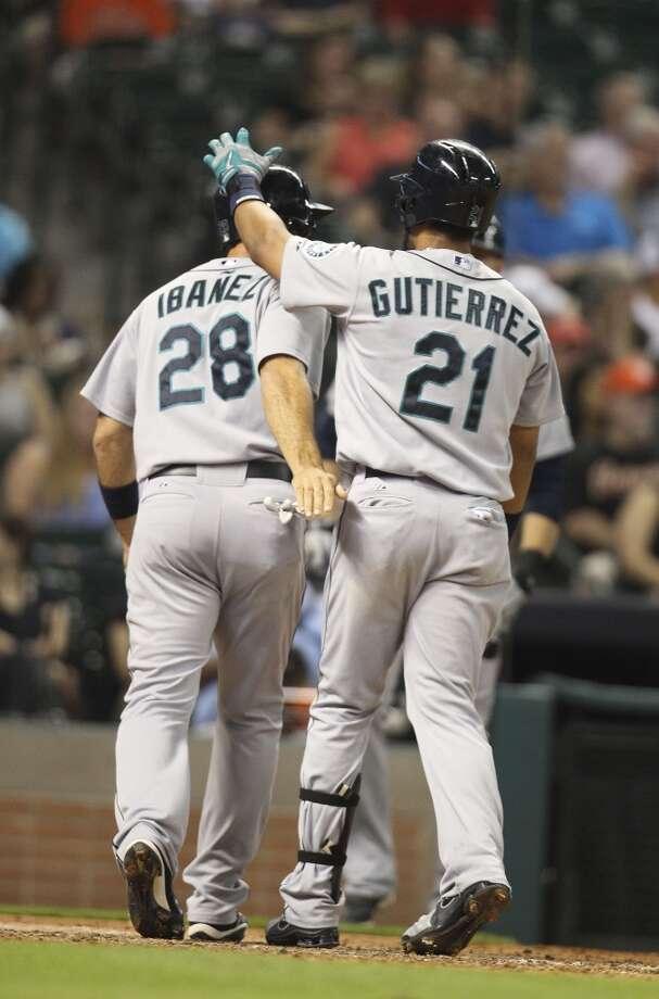 Mariners center fielder Franklin Gutierrez celebrates his two-run home run with Raul Ibanez. Photo: Karen Warren, Houston Chronicle