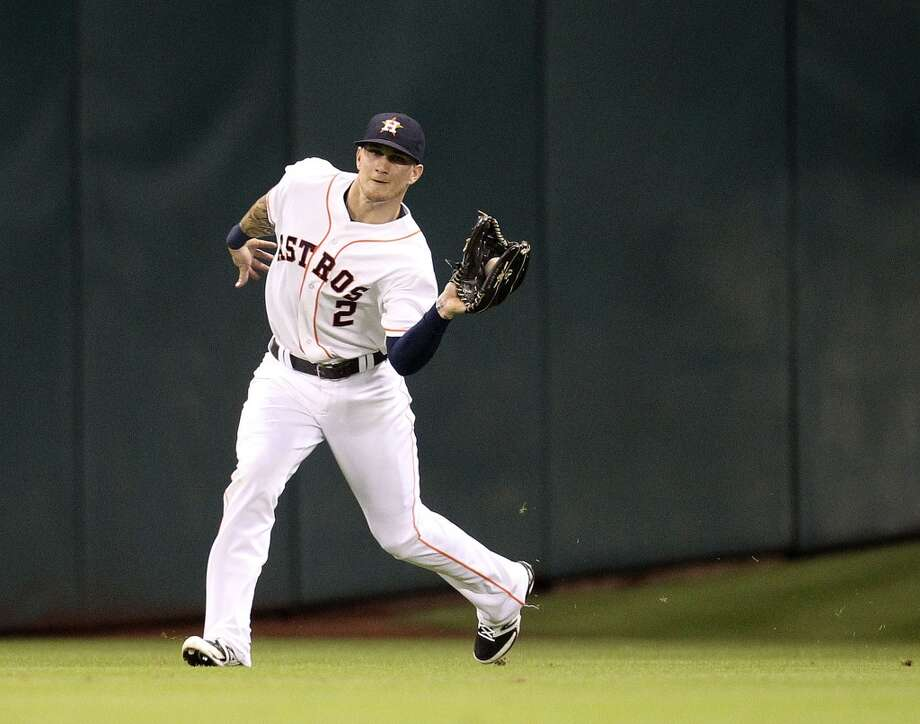 Astros center fielder Brandon Barnes catches a ball hit by Mariners center fielder Franklin Gutierrez. Photo: Karen Warren, Houston Chronicle