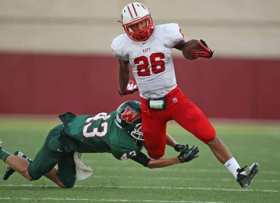 Last season's champs set for encoreThe Houston area had three 2012 UIL state champions (Katy, Navasota and East Bernard) and the SPC large school winner in Episcopal. Each lost star power, but another playoff run is possible. Rodney Anderson (pictured) is Katy's next premier running back and has the versatility to be dangerous everywhere on the field. The Tigers are also the only champion to return their quarterback - Kiley Huddleston has already shown his toughness. Navasota will lean on its Jordan Wells-led defense early, while East Bernard's collective athleticism should help replace title game offensive MVP Ty Slanina (TCU). Episcopal has its next quarterback, but watch for junior tailback Tyreik Gray to make a bigger name for himself. Photo: Eric Christian Smith, For The Chronicle