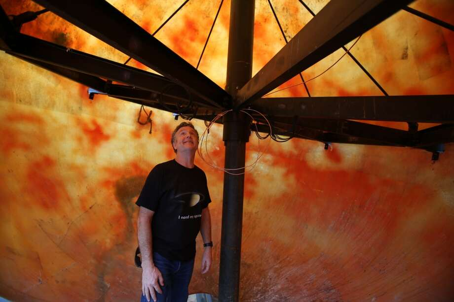 Building owner Brian Regan looks in the globe. Photo: JOSHUA TRUJILLO, SEATTLEPI.COM