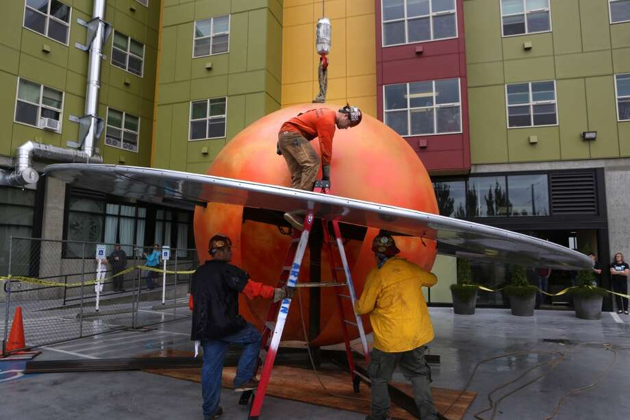 A 12 foot-tall fiberglass replica of the planet Saturn is readied to be installed. Photo: JOSHUA TRUJILLO, SEATTLEPI.COM