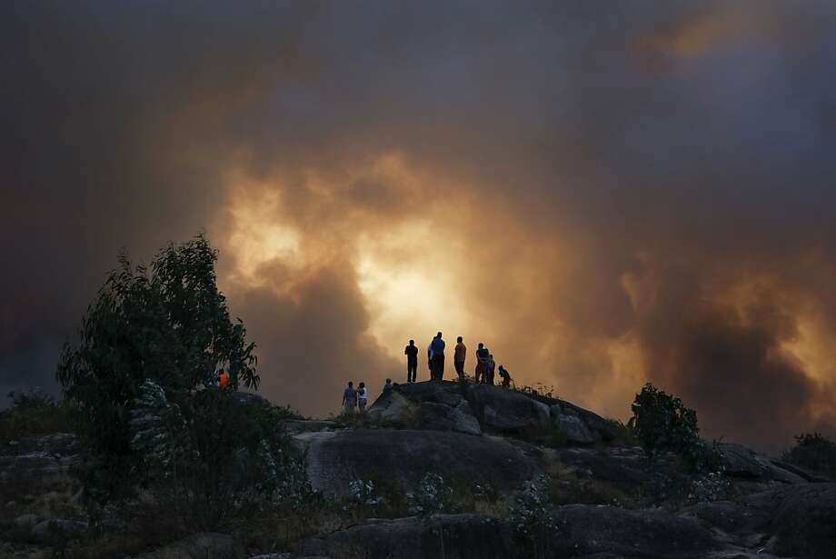 The Iberian Peninsula is on fire: Like Portugal, Spain has had its share of wildfires this summer, partially due to an extremely dry winter. This blaze is burning in Lousame, near A Coruna. Photo: Pedro Armestre, AFP/Getty Images