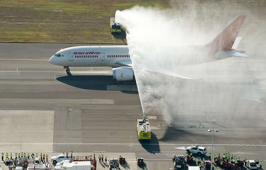 """Air India's inaugural flight from New Delhi to Sydney receives a water salute after landing in Sydney on August 30, 2013.  The Dreamliner (Boeing 787) jet arrived in Australia for the first time, courtesy of Air India which resumed direct services to the country after a 16-year absence.  The carrier is hoping to take advantage of what it called the """"untapped potential"""" in the Australian market.  Air India's country manager Ravi Bodade told reporters he was confident of regularly filling the daily services that also go via Melbourne on the 256-seat Boeing 787-880 Dreamliner planes.  AFP PHOTO/HO/James MORGAN  ----EDITORS NOTE ----RESTRICTED TO EDITORIAL USE MANDATORY CREDIT """" AFP PHOTO / JAMES MORGAN"""" NO MARKETING NO ADVERTISING CAMPAIGNS - DISTRIBUTED AS A SERVICE TO CLIENTS - NO ARCHIVESJAMES MORGAN/AFP/Getty Images Photo: James Morgan, AFP/Getty Images"""
