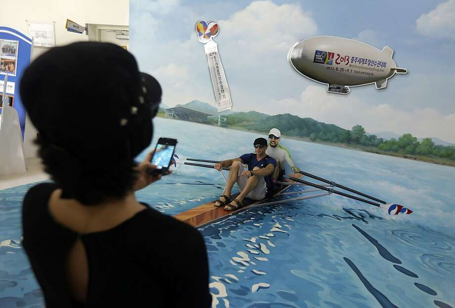 Visitors take their souvenir photos during the World Rowing Championships in Chungju, south of Seoul, South Korea, Thursday, Aug. 29, 2013. (AP Photo/Lee Jin-man) Photo: Lee Jin-man, Associated Press