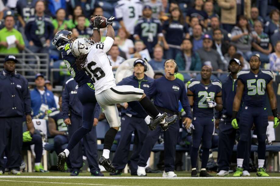 Seahawks player Stephen Williams, left background, and Raiders player Usama Young, left foreground, compete to catch a pass in mid-air during the first half of the final preseason game Thursday, August 29, 2013, at CenturyLink Field in Seattle. Seahawks led the Raiders 13-3 at the end of the first half. (Jordan Stead, seattlepi.com) Photo: JORDAN STEAD, SEATTLEPI.COM