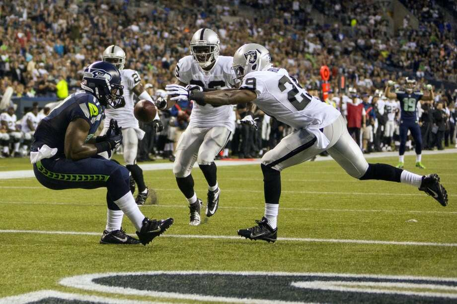 Chris Harper, left, narrowly misses an end zone catch during the first half of the final preseason game against the Oakland Raiders Thursday, August 29, 2013, at CenturyLink Field in Seattle. Seahawks led the Raiders 13-3 at the end of the first half. (Jordan Stead, seattlepi.com) Photo: JORDAN STEAD, SEATTLEPI.COM