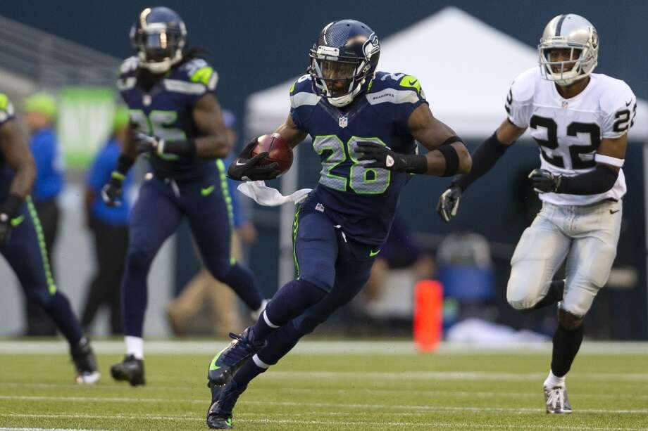 Walter Thurmond, center, tears downfield during the first half of the final preseason game Thursday, August 29, 2013, at CenturyLink Field in Seattle. Seahawks led the Raiders 13-3 at the end of the first half. (Jordan Stead, seattlepi.com) Photo: JORDAN STEAD, SEATTLEPI.COM