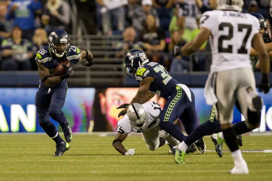 Walter Thurmond, left, makes a break for it downfield during the first half of the final preseason game against the Oakland Raiders Thursday, August 29, 2013, at CenturyLink Field in Seattle. Seahawks led the Raiders 13-3 at the end of the first half. (Jordan Stead, seattlepi.com) Photo: JORDAN STEAD, SEATTLEPI.COM