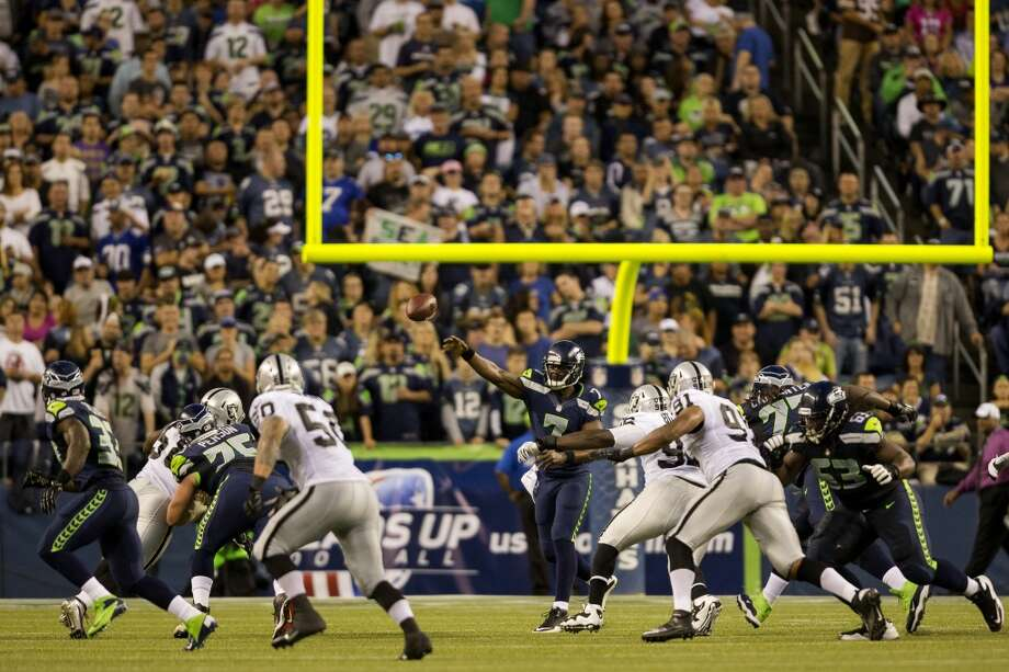 Quarterback Tarvaris Jackson, center, passes downfield during the first half of the final preseason game Thursday, August 29, 2013, at CenturyLink Field in Seattle. Seahawks led the Raiders 13-3 at the end of the first half. (Jordan Stead, seattlepi.com) Photo: JORDAN STEAD, SEATTLEPI.COM