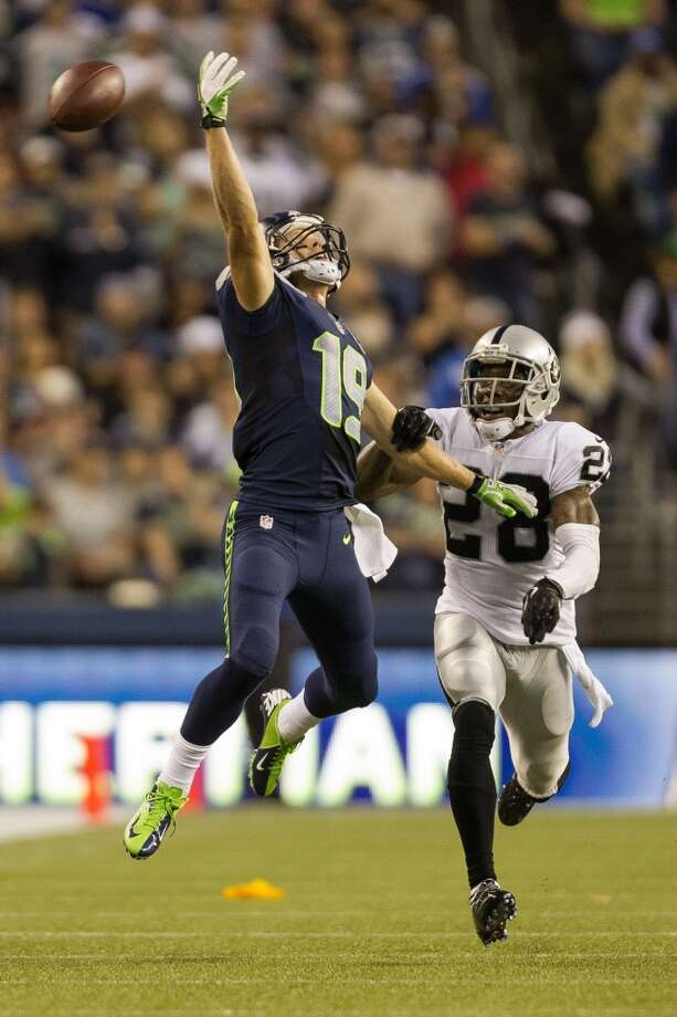 Bryan Walters, left, misses a ball during the first half of the final preseason game Thursday, August 29, 2013, at CenturyLink Field in Seattle. Seahawks led the Raiders 13-3 at the end of the first half. (Jordan Stead, seattlepi.com) Photo: JORDAN STEAD, SEATTLEPI.COM