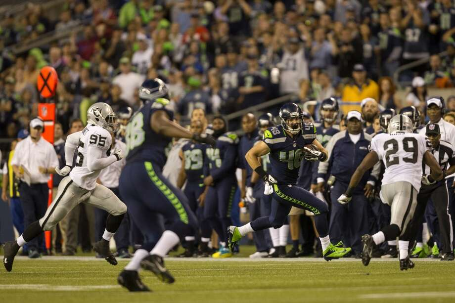 Cooper Helfet, center right, moves along the sideline in an attempt to move past Raiders defense during the first half of the final preseason game Thursday, August 29, 2013, at CenturyLink Field in Seattle. Seahawks led the Raiders 13-3 at the end of the first half. (Jordan Stead, seattlepi.com) Photo: JORDAN STEAD, SEATTLEPI.COM