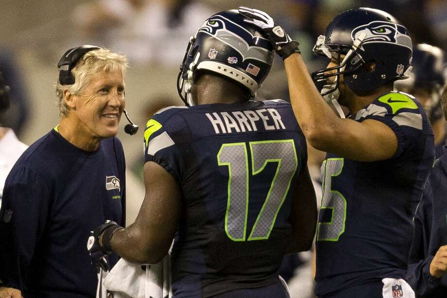 Head coach Pete Carroll, left, chats with Chris Harper, center, on a timeout during the first half of the final preseason game Thursday, August 29, 2013, at CenturyLink Field in Seattle. Seahawks led the Raiders 13-3 at the end of the first half. (Jordan Stead, seattlepi.com) Photo: JORDAN STEAD, SEATTLEPI.COM
