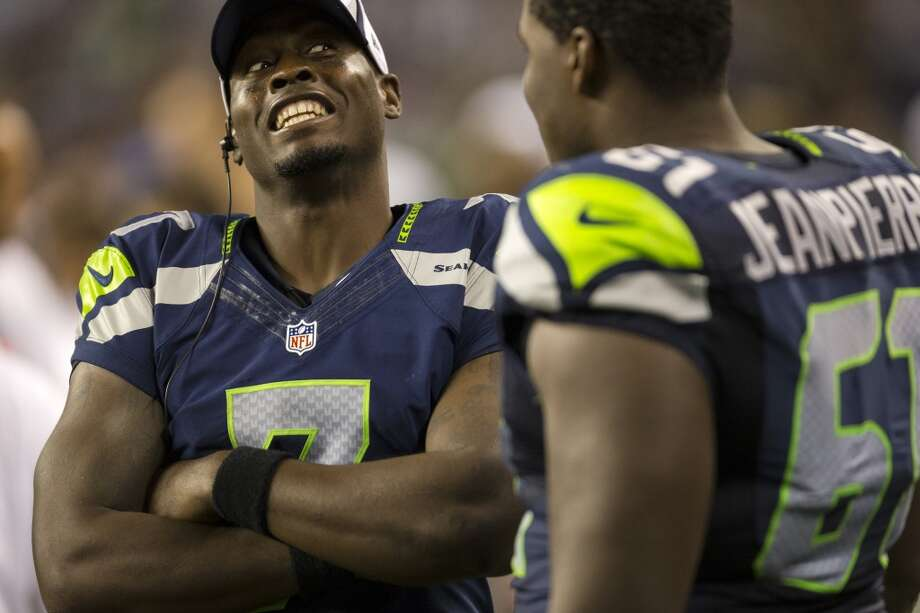 Quarterback Tarvaris Jackson, left, jokes around with teammates on the sideline during the second half of the final preseason game Thursday, August 29, 2013, at CenturyLink Field in Seattle. The Seahawks beat the Raiders 22-6. (Jordan Stead, seattlepi.com) Photo: JORDAN STEAD, SEATTLEPI.COM