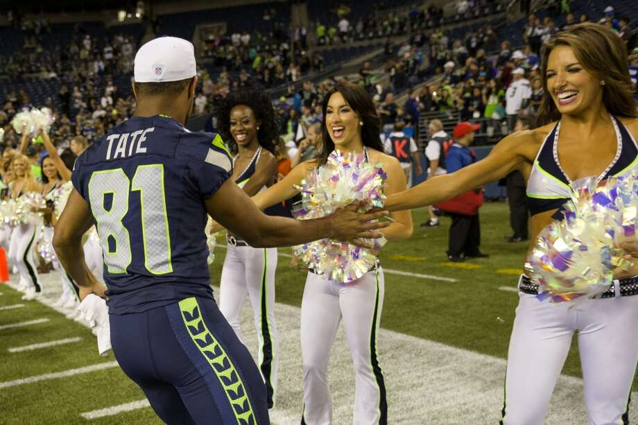 Golden Tate, left, gives the Sea Gals high fives while leaving the field following the final preseason game Thursday, August 29, 2013, at CenturyLink Field in Seattle. The Seahawks beat the Raiders 22-6. (Jordan Stead, seattlepi.com) Photo: JORDAN STEAD, SEATTLEPI.COM