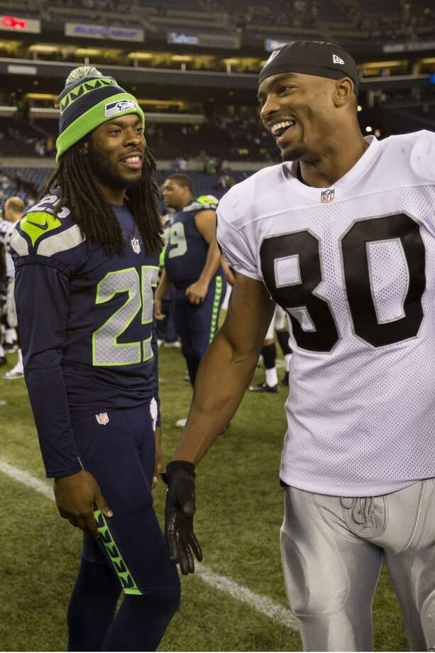 Richard Sherman, left, and Rod Streater, right, chat following the final preseason game Thursday, August 29, 2013, at CenturyLink Field in Seattle. The Seahawks beat the Raiders 22-6. (Jordan Stead, seattlepi.com) Photo: JORDAN STEAD, SEATTLEPI.COM