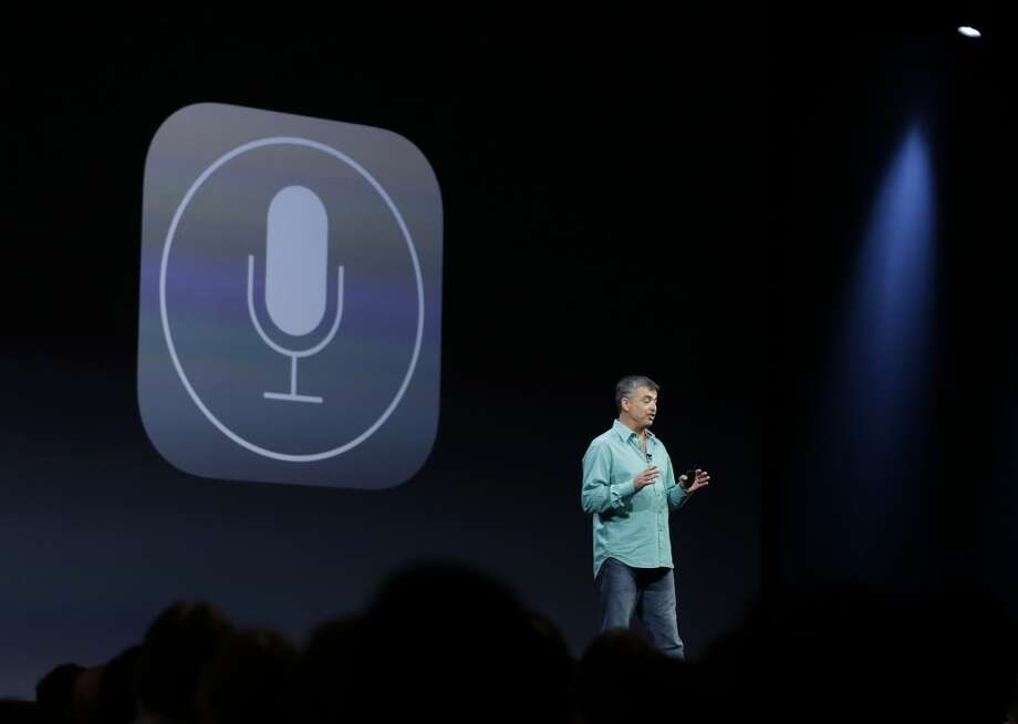 Eddy Cue, the Apple senior vice president of Internet Software and Services, talks about the new voices of Siri virtual assistant during the keynote address of the Apple Worldwide Developers Conference Monday, June 10, 2013 in San Francisco. Apple said the Siri will use searches from Microsoft's Bing, Google's rival in addition to having a male and foreign language option. (AP Photo/Eric Risberg) Photo: Associated Press