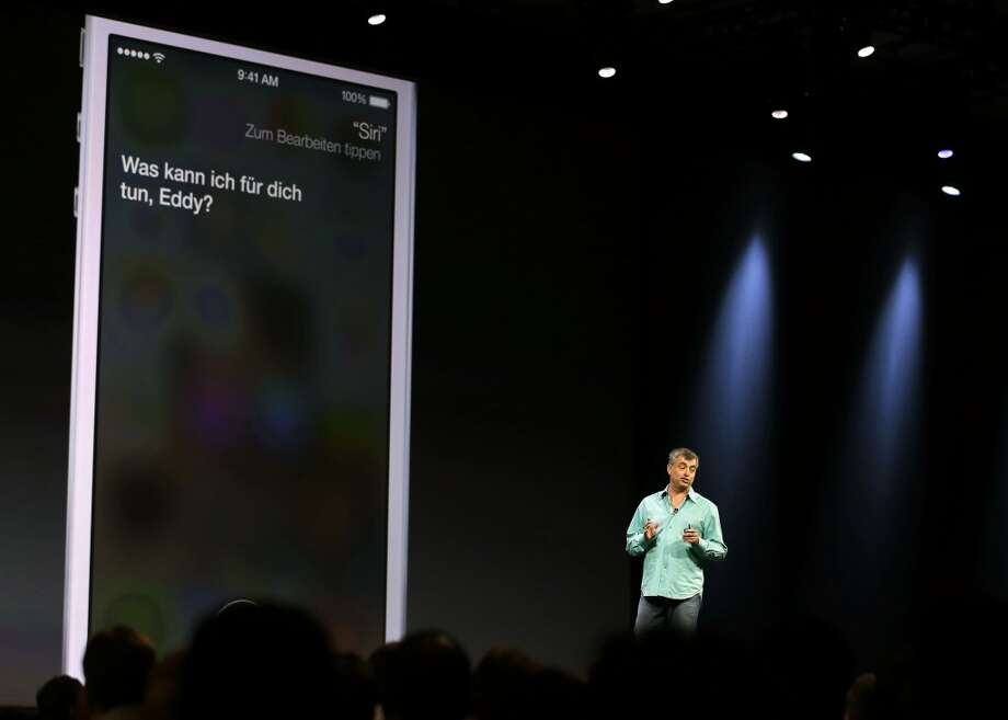 Eddy Cue, the Apple senior vice president of Internet Software and Services, talks about the new voices of Siri virtual assistant during the keynote address of the Apple Worldwide Developers Conference Monday, June 10, 2013 in San Francisco. Apple said the Siri will use searches from Microsoft's Bing, Google's rival, in addition to having a male and foreign language option. (AP Photo/Eric Risberg) Photo: Associated Press