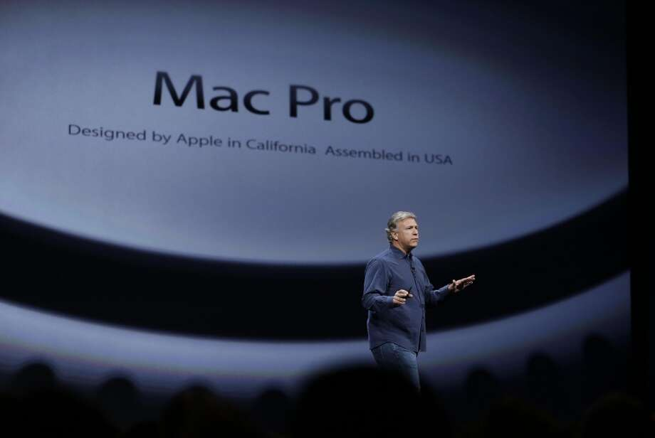 Phil Schiller the senior vice president of worldwide marketing at Apple talks about the new Mac Pro during the keynote address of the Apple Worldwide Developers Conference Monday, June 10, 2013 in San Francisco. (AP Photo/Eric Risberg) Photo: Associated Press