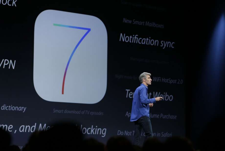 Craig Federighi, senior vice president of Software Engineering at Apple talks about the features of the new iOS 7 during the keynote address of the Apple Worldwide Developers Conference Monday, June 10, 2013 in San Francisco. (AP Photo/Eric Risberg) Photo: Associated Press