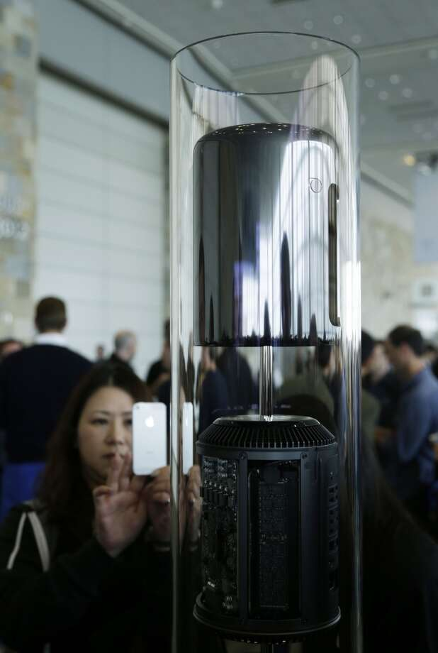 The new Mac Pro is previewed at the Apple Worldwide Developers Conference Monday, June 10, 2013 in San Francisco. The new Mac Pro will be the first Mac to be assembled in the U.S. in many years. CEO Tim Cook promised last year that the company would start a production line in the U.S., but didn't say where. Apple said the new computer will launch later this year.(AP Photo/Eric Risberg) Photo: Associated Press