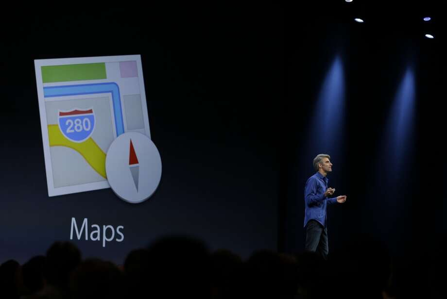 Craig Federighi, senior vice president of Software Engineering at Apple talks about improvements to the Maps app during the keynote address of the Apple Worldwide Developers Conference Monday, June 10, 2013 in San Francisco. (AP Photo/Eric Risberg) Photo: Associated Press