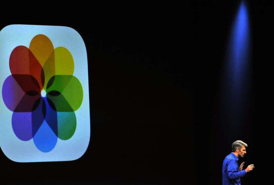 Apple's Senior Vice President of Software Engineering Craig Federighi announces speaks at Apple's Worldwide Developer Conference (WWDC) in San Francisco on June 10, 2013. Apple unveiled its hotly anticipated iTunes Radio Service, as the iconic maker of the iPhone moved to challenge streaming music operators like Pandora and Spotify.    AFP PHOTO/Josh EdelsonJosh Edelson/AFP/Getty Images Photo: AFP/Getty Images