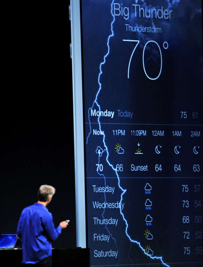 A bolt of lightning streaks across a digital sky as Apple's Senior Vice President of Software Engineering Craig Federighi explains updates to the weather app for the iPhone at Apple's Worldwide Developer Conference (WWDC) in San Francisco on June 10, 2013.   Apple unveiled its hotly anticipated iTunes Radio Service, as the iconic maker of the iPhone moved to challenge streaming music operators like Pandora and Spotify.    AFP PHOTO/Josh EdelsonJosh Edelson/AFP/Getty Images Photo: AFP/Getty Images