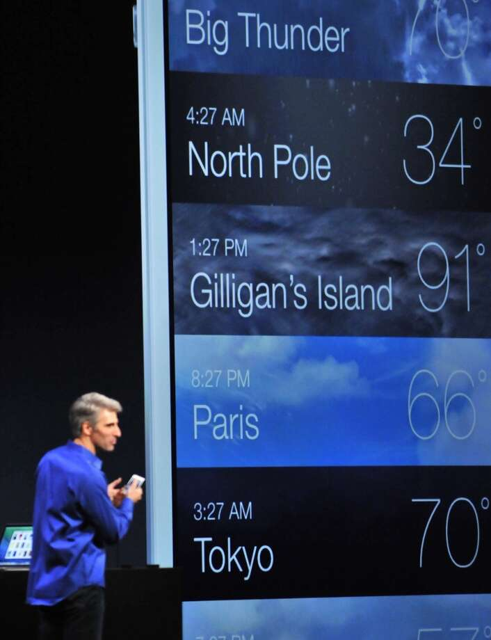 Apple's Senior Vice President of Software Engineering Craig Federighi explains updates to the weather app for the iPhone at Apple's Worldwide Developer Conference (WWDC) in San Francisco on June 10, 2013. Apple unveiled its hotly anticipated iTunes Radio Service, as the iconic maker of the iPhone moved to challenge streaming music operators like Pandora and Spotify.    AFP PHOTO/Josh EdelsonJosh Edelson/AFP/Getty Images Photo: AFP/Getty Images