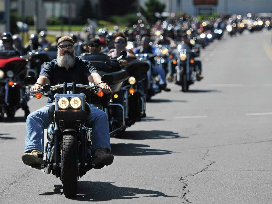 A motorcyclist leads the group in the 13th annual Dream Ride Experience at Danbury Harley Davidson in Danbury, Conn. on Sunday, Aug. 25, 2013.  Motorcyclists from 13 states, as far away as Florida, rode together to celebrate the achievements of Special Olympic athletes.  Well over 100 riders gathered at Danbury Harley Davidson before riding away to the final stop on the tour in Farmington.  Since its start in 2001, the Dream Ride has donated nearly $2 million to help the Special Olympics. Photo: Tyler Sizemore / The News-Times