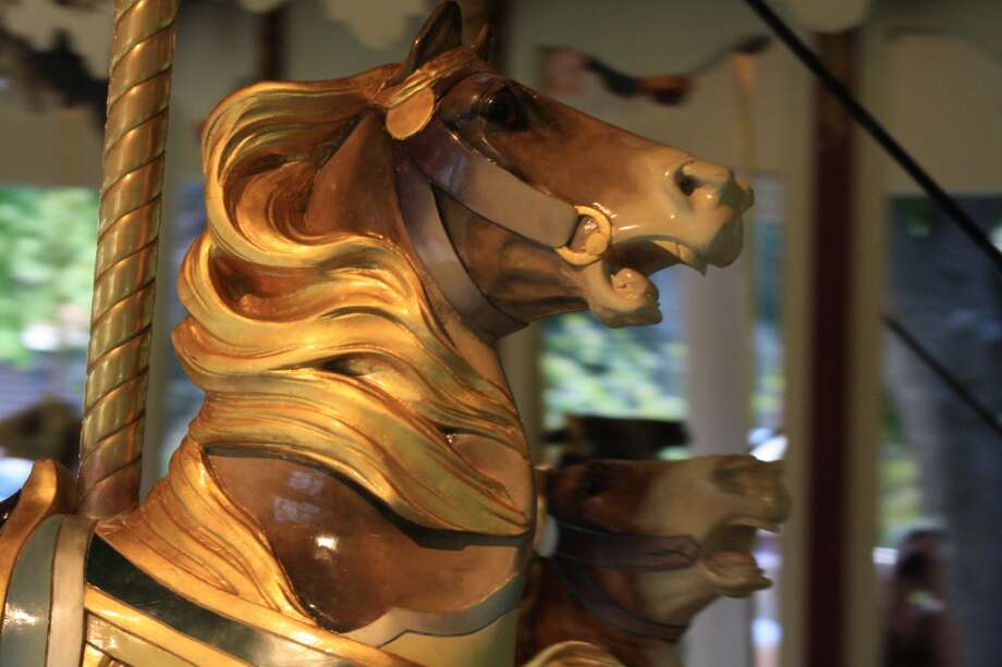 The carousel is a visual feast of charging steeds with glorious manes. (Valerie DeLaCruz)