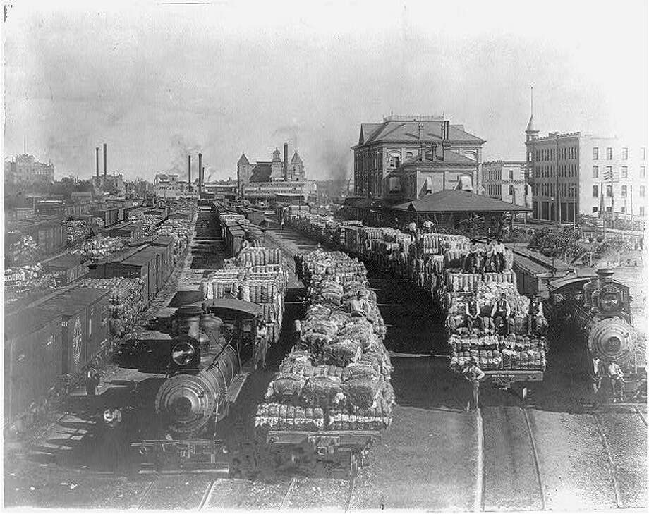 Trains carrying cotton in a Houston rail yard.