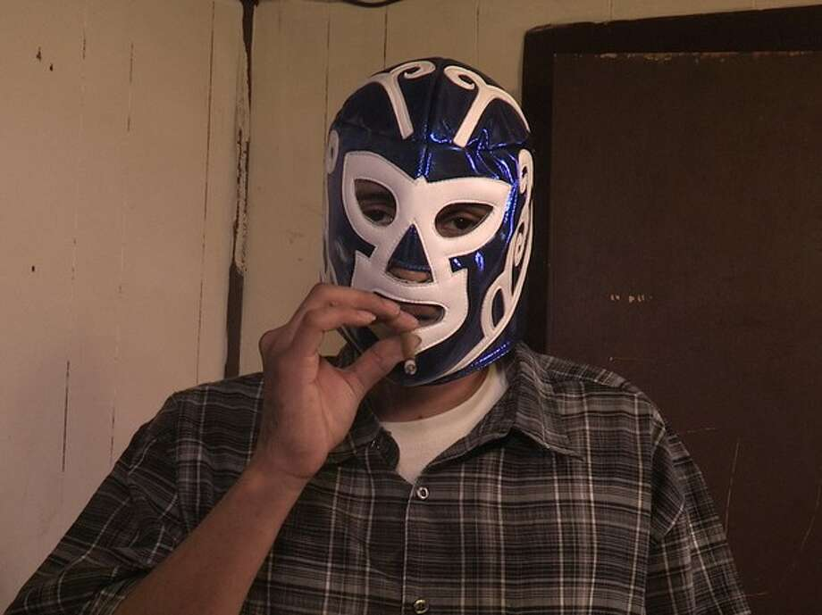 The leader of the Mexican cartel in a lucha libre mask. Drug investigators in the Houston HIDTA (High Intensity Drug Trafficking Areas) report a recent increase in the surrounding communities of ice methamphetamine from Mexican drug cartels. Photo: Wall To Wall Media