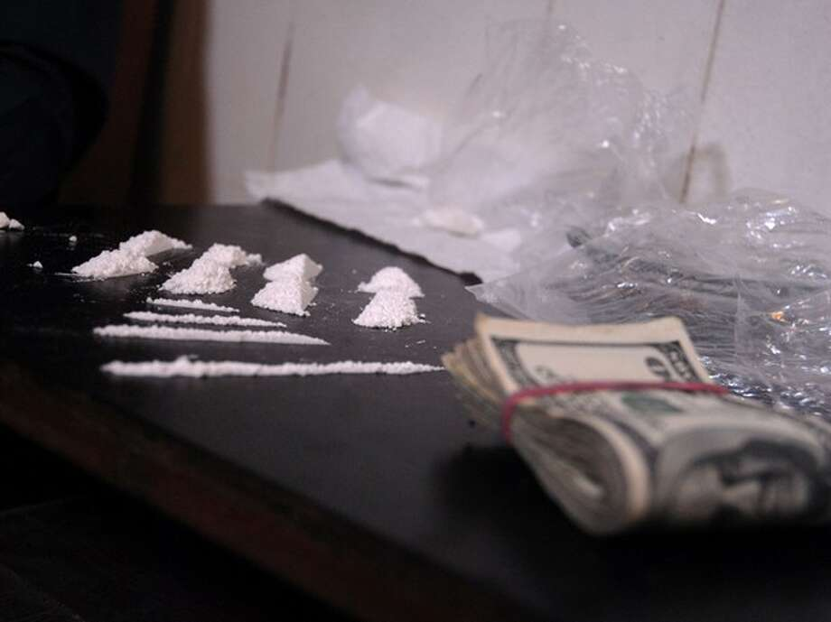 Powder cocaine and cash. Photo: Wall To Wall Media